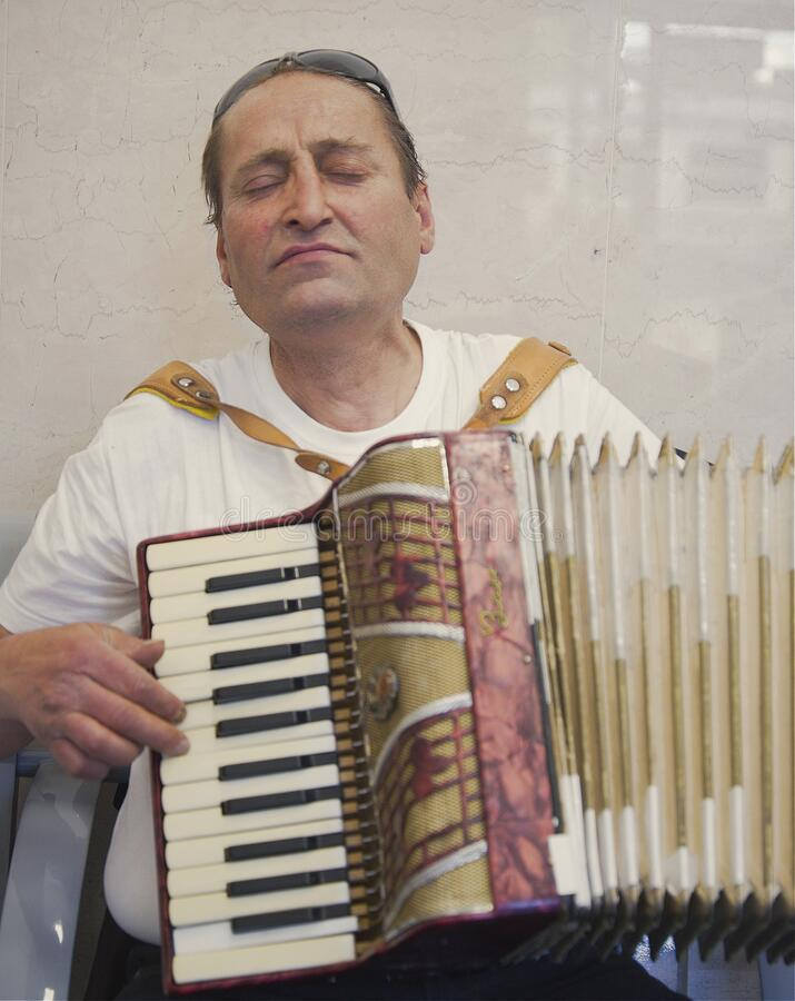 Free Portrait Of A Homeless Man Playing His Accordion With Great Passion Royalty Free Stock Photo - 217076525