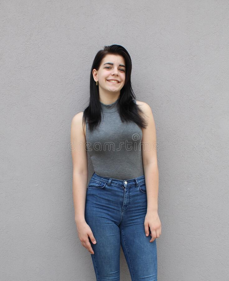 Free Portrait Of A Young Black-haired Girl In Front Of A Gray Background Royalty Free Stock Image - 183208566