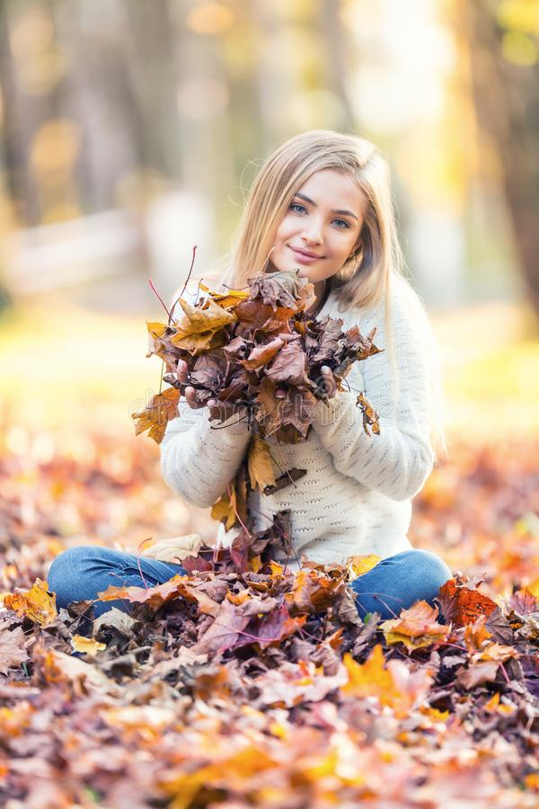 Free Portrait Of A Young Woman Enjoying The Autumn Atmosphere And Playing From Maple Leaves In Park Stock Photo - 161150890