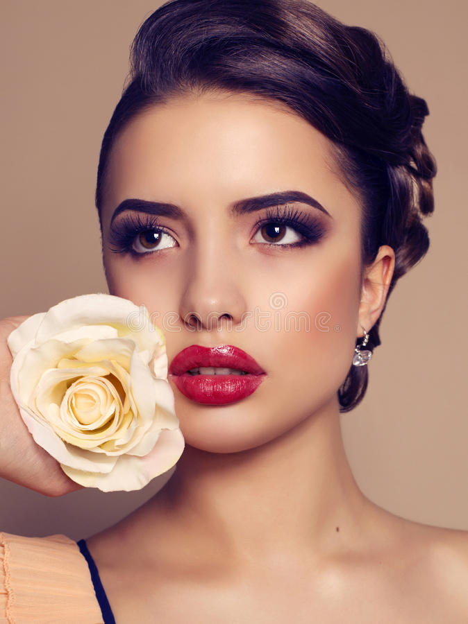 Free Portrait Of Beautiful Brunette Woman With Rose Royalty Free Stock Image - 38610136
