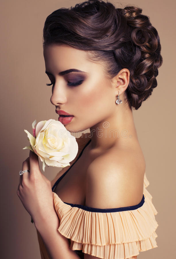 Free Portrait Of Beautiful Young Woman With Rose Stock Image - 38610191