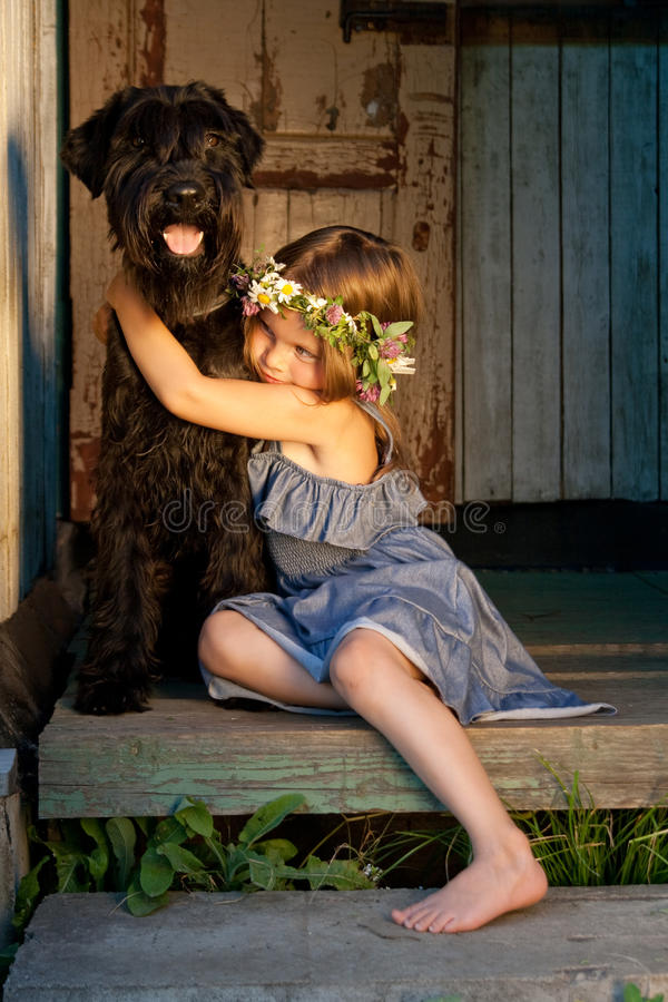 Free Portrait Of Beautifull Girl And Her Black Dog. Royalty Free Stock Photography - 15159077