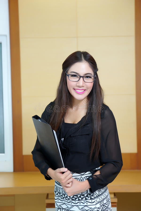 Free Portrait Of Confident Young Businesswoman With File Folder In Of Stock Images - 34624304