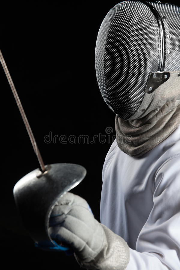 Free Portrait Of Fencer Woman Wearing White Fencing Costume Practicing With The Sword. Isolated On Black Background. Stock Photography - 87816742