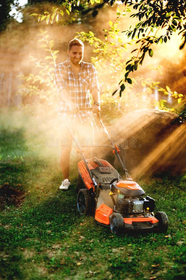 Free Portrait Of Gardener Mowing The Lawn Using A Gasoline Powered Device, A Professional Lawn Mower Royalty Free Stock Image - 156868246