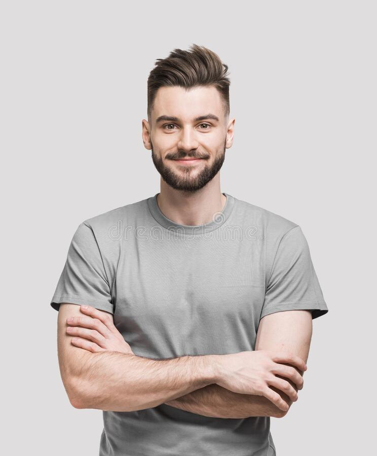 Free Portrait Of Handsome Smiling Young Man With Folded Arms. Smiling Joyful Cheerful Men With Crossed Hands Isolated Studio Shot. Royalty Free Stock Photo - 172869765