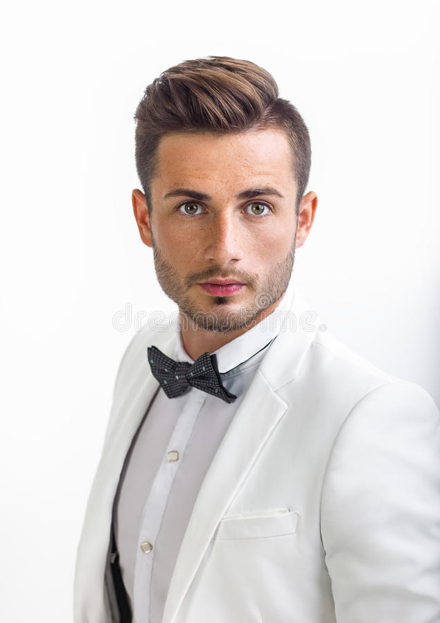 Free Portrait Of Handsome Stylish Man In White Elegant Suit Royalty Free Stock Photos - 96187778