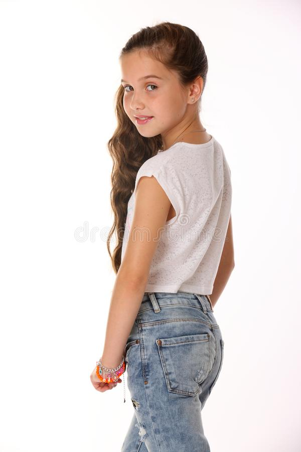 Free Portrait Of Lovely Beautiful Slender Child Girl In Blue Jeans Stock Image - 107840291