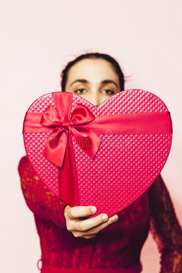 Free Portrait Of Lovely Woman Covering Face With Giftbox. Valentines Day Gifts. Beautiful Middle-eastern Girl Receives Heart-shaped Stock Photos - 167995333