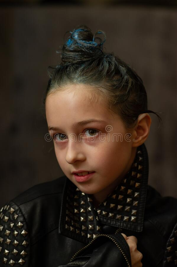 Free Portrait Of Nine Year Old Girl. Teenager With Blue Strands On Her Hair. A Series Of Photos Of A Girl Of 8 Or 9 Years Old Royalty Free Stock Image - 172510766