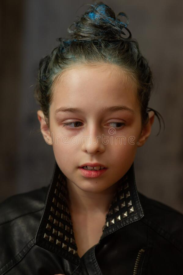 Free Portrait Of Nine Year Old Girl. Teenager With Blue Strands On Her Hair. A Series Of Photos Of A Girl Of 8 Or 9 Years Old Stock Photos - 172510843