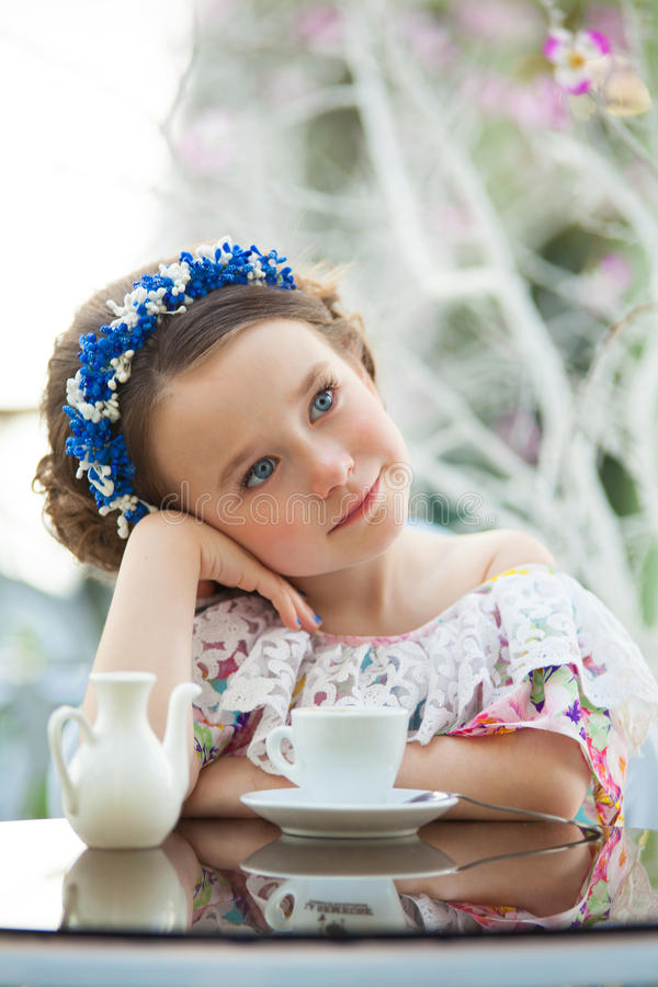 Free Portrait Of Pensive Child Girl In A Floral Dress Stock Photography - 57484952