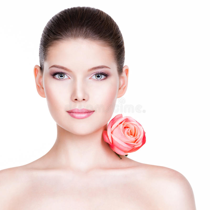 Free Portrait Of Pretty Face Of Beautiful Woman With A Pink Rose. Royalty Free Stock Image - 46346146