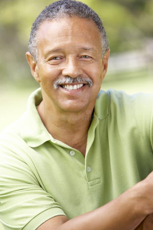 Free Portrait Of Senior Man In Park Royalty Free Stock Image - 12404546