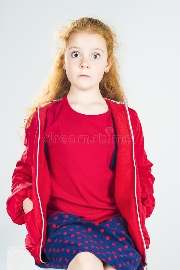 Free Portrait Of Surprised Redhaired Caucasian Little Girl In Red Jacket And Polka Dotted Skirt Royalty Free Stock Photos - 43806978