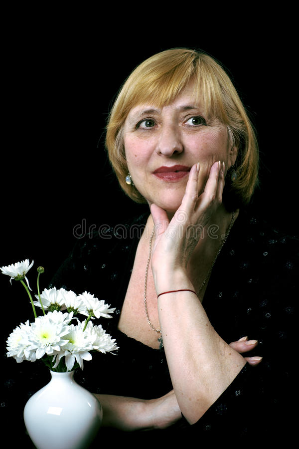 Free Portrait Of The Senior Women With Flowers Royalty Free Stock Photo - 14481345