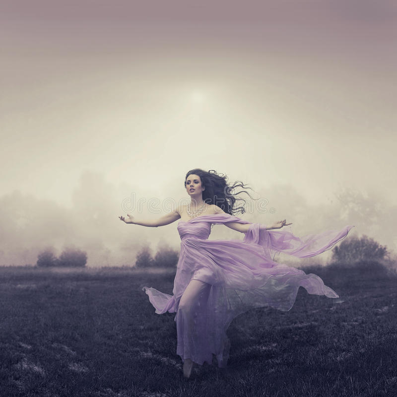Free Portrait Of Woman Running Over The Field Royalty Free Stock Photo - 28859495