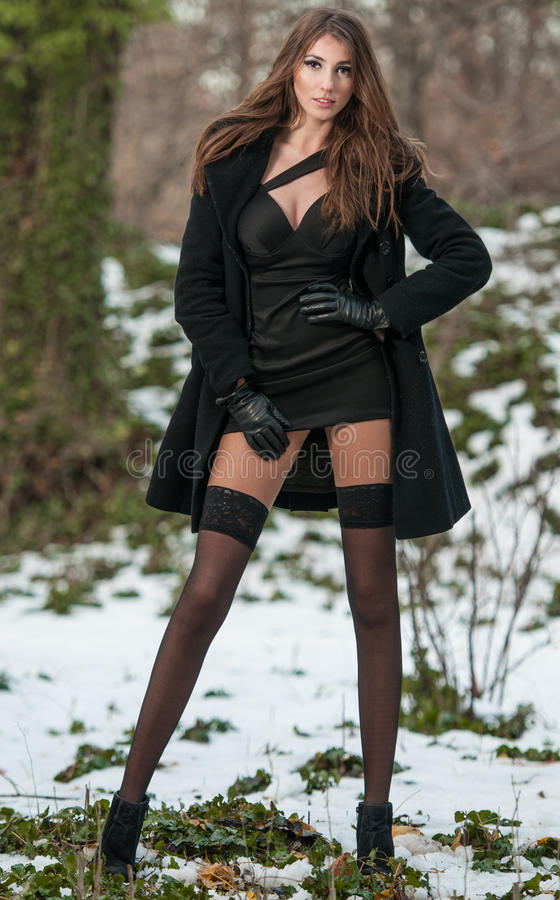Free Portrait Of Young Beautiful Woman Outdoor In Winter Scenery. Sensual Brunette With Long Legs In Black Stockings Posing Fashionable Royalty Free Stock Images - 44985189