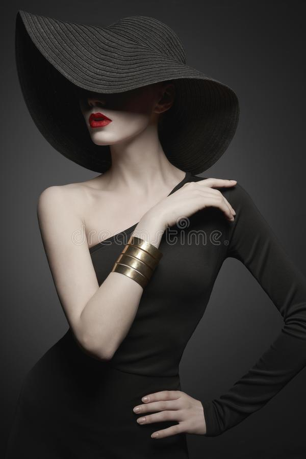 Free Portrait Of Young Lady With Black Hat And Evening Dress Royalty Free Stock Photography - 138143137