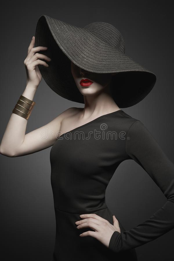 Free Portrait Of Young Lady With Black Hat And Evening Dress Royalty Free Stock Photos - 138143138