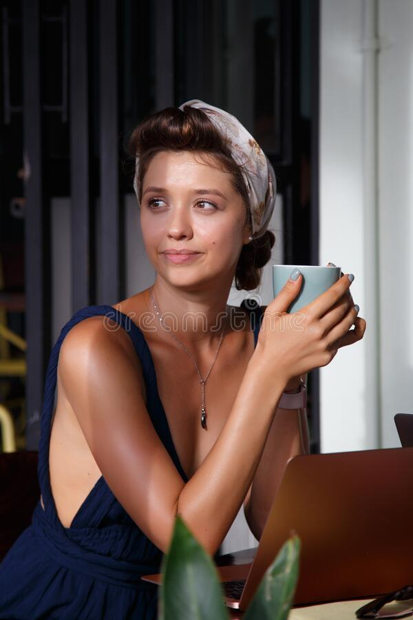 Free Portrait Of Young Woman Drinking Coffee At Table With Notebook In Cafe Royalty Free Stock Photos - 187752138