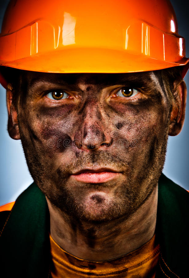 Portrait oil industry worker. Oil industry worker on blue background stock images