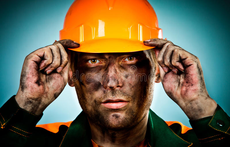 Portrait oil industry worker. Oil industry worker on blue background royalty free stock images