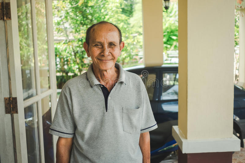 Portrait of old asian thin man. Domestic life royalty free stock images