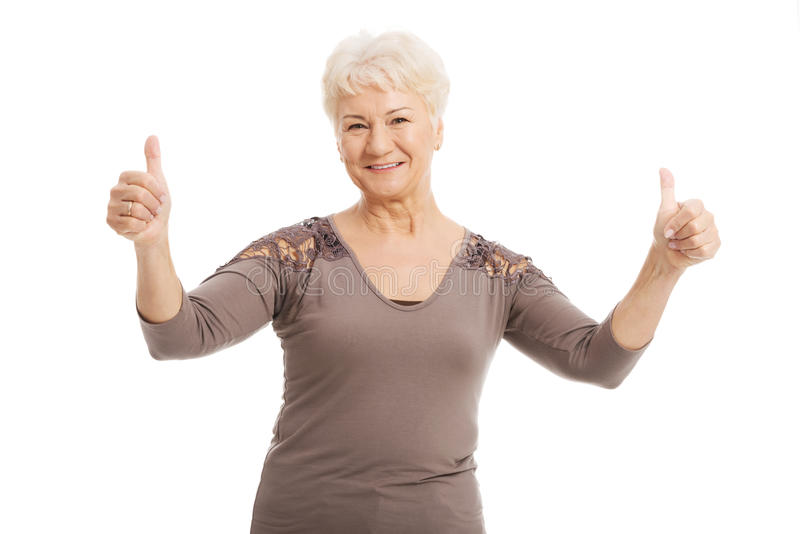 Portrait of an old lady showing OK. stock images