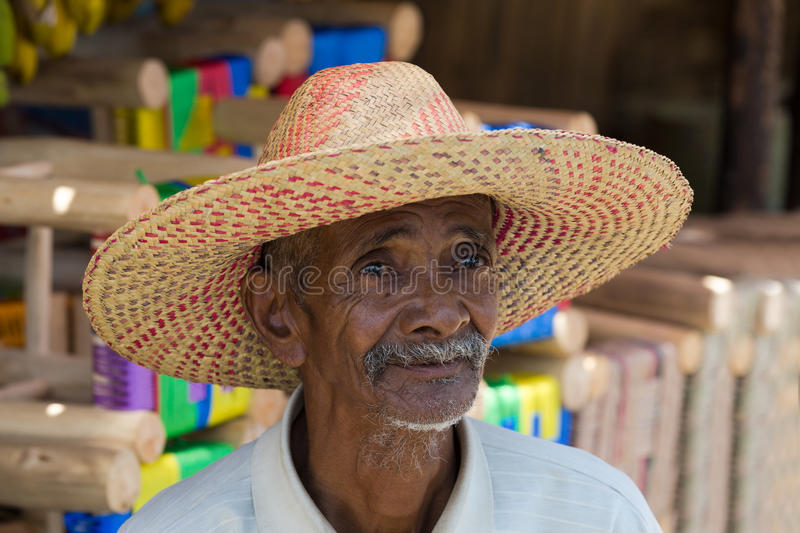 Portrait of old Malagasy man with straw hat stock photo