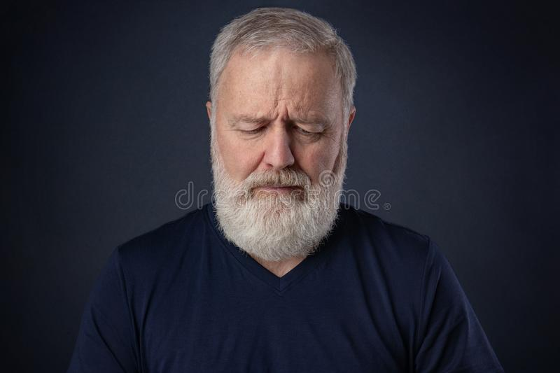Portrait of the old man looking down royalty free stock photography