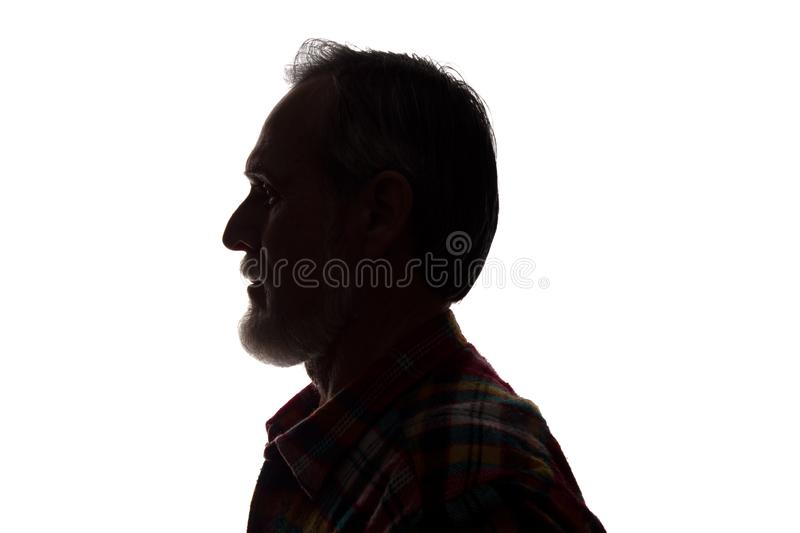 Portrait of a old man, side view - dark close-up silhouette royalty free stock photography