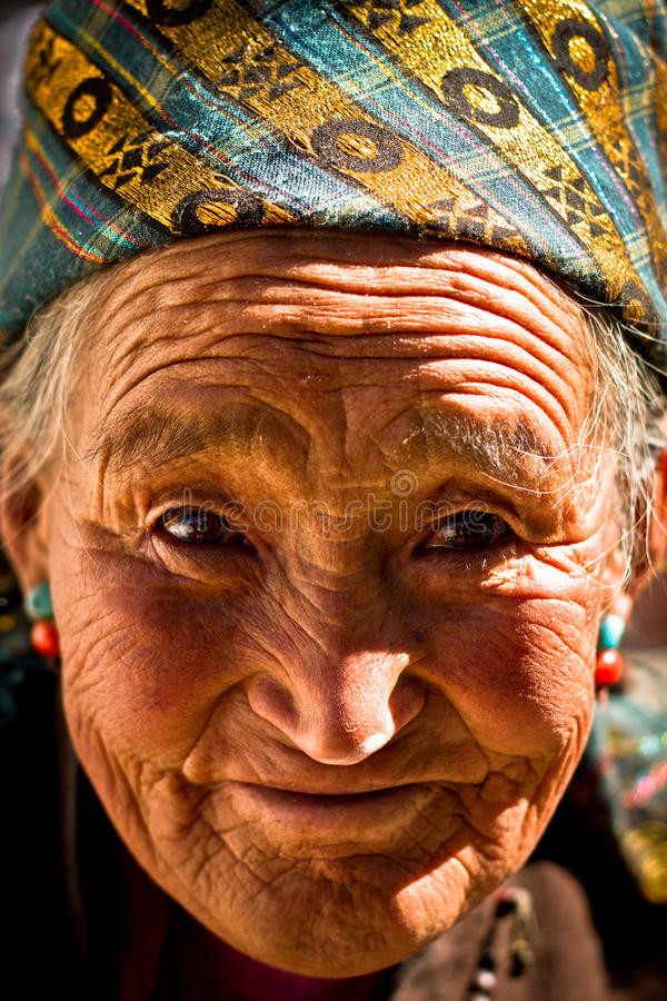 Portrait of an old smiling woman from Tibet. Portrait of an elderly smiling woman from Tibet royalty free stock images