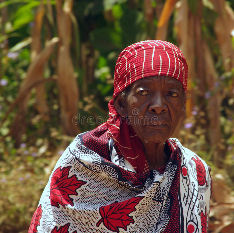 Portrait of an old Tanzanian woman. Portrait old Tanzanian woman in bright clothes stock photo