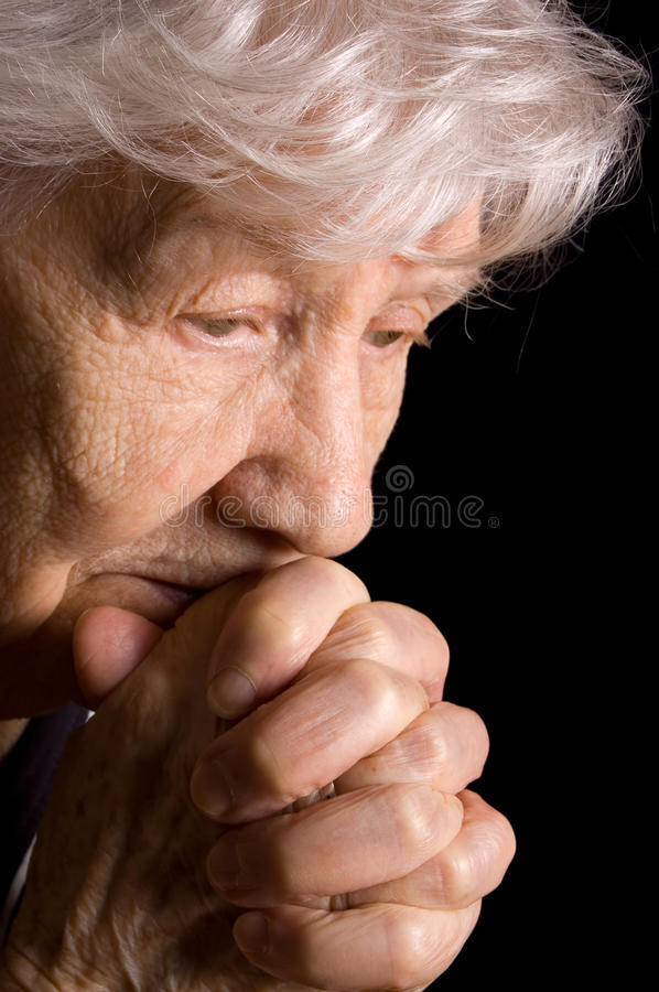 Portrait of the old woman a black. Background stock photos