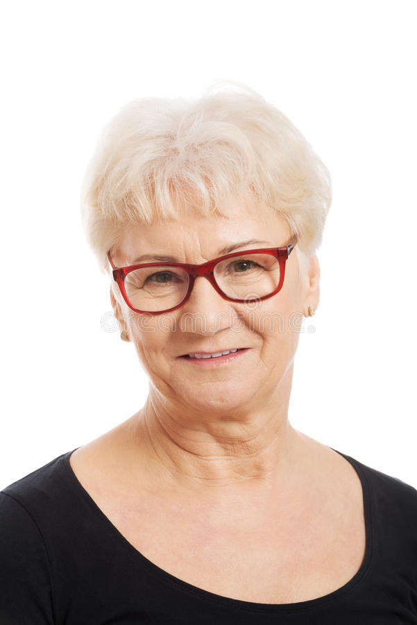 Portrait of an old woman in eyeglasses. royalty free stock image