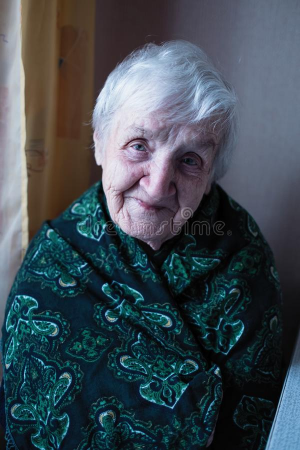 Portrait of an old woman gray-haired pensioner stock photo