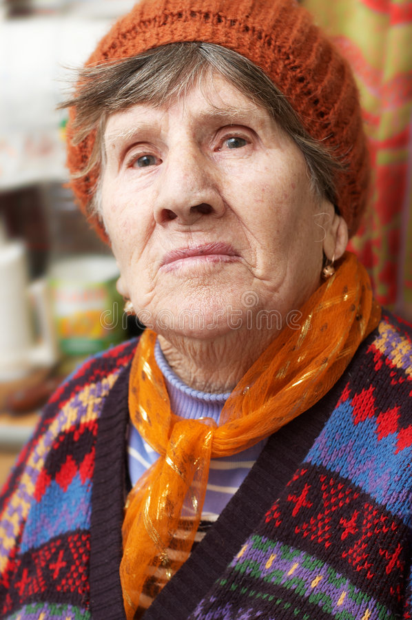 Portrait of old woman in red beret stock photography