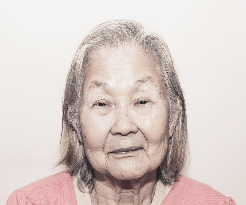 Portrait of a old woman with white hair. Close up on the face, Brazilian woman, Japanese descendant stock image