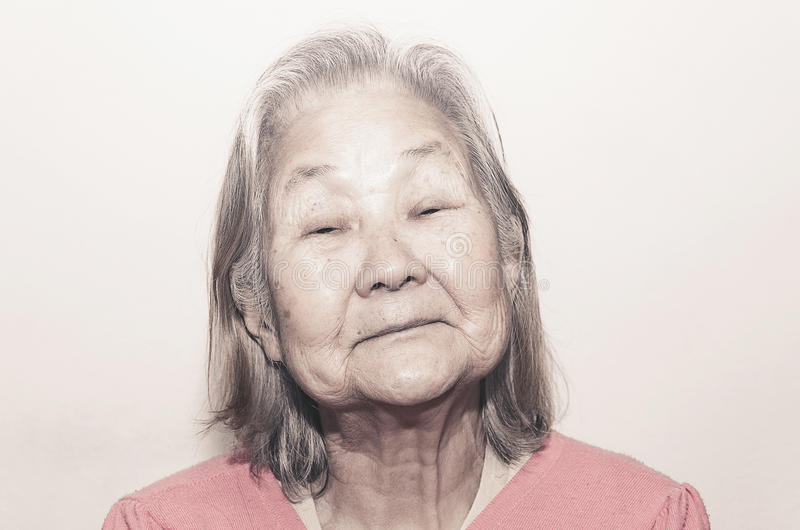 Portrait of a old woman with white hair. Close up on the face, Brazilian woman, Japanese descendant with serious expression royalty free stock photos