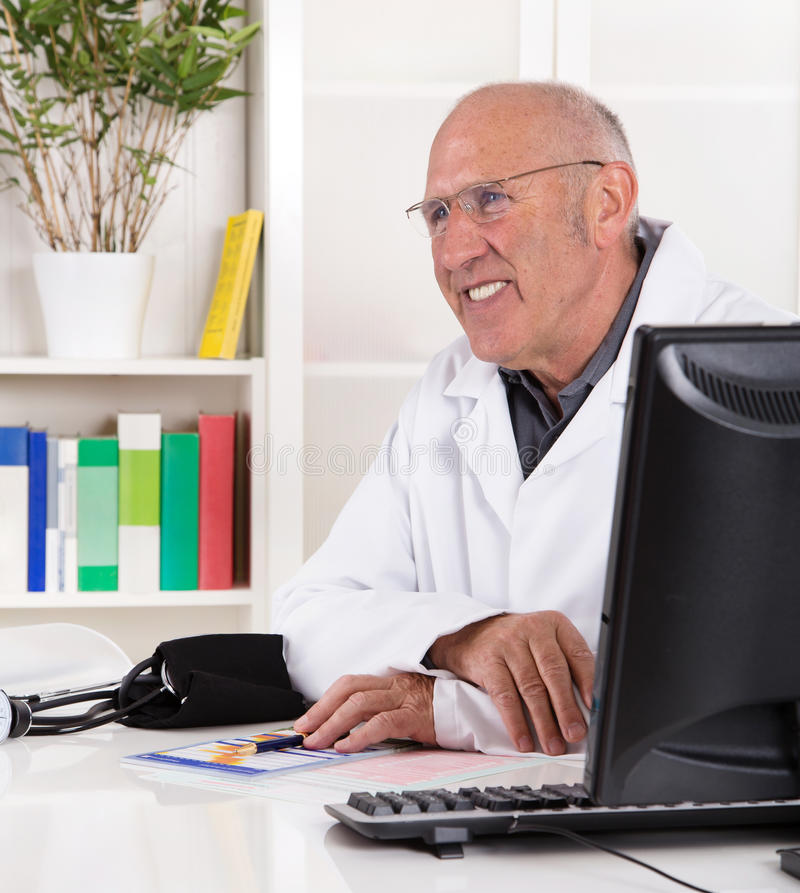 Portrait older doctor with experience smiling. Portrait of an older doctor with experience smiling royalty free stock photo