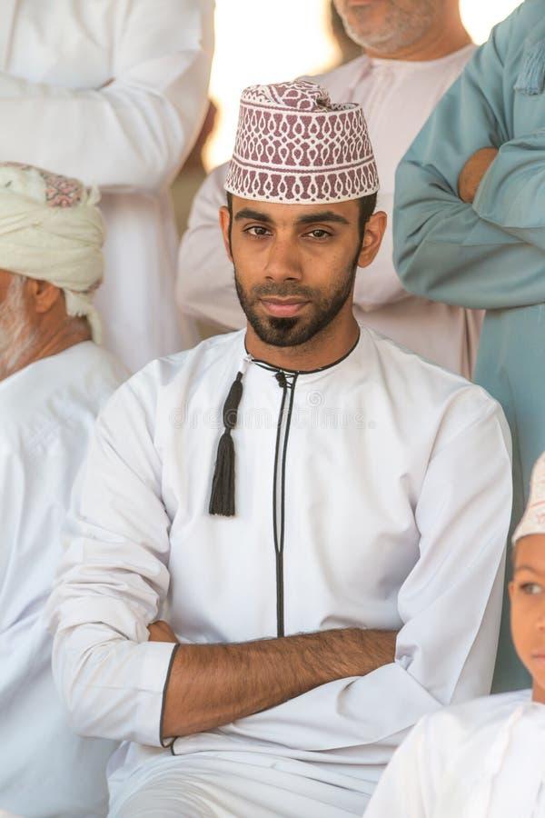 Portrait of an Omani man in a traditional Omani dress. Nizwa, Oman - 15/OCT/2016 stock photography