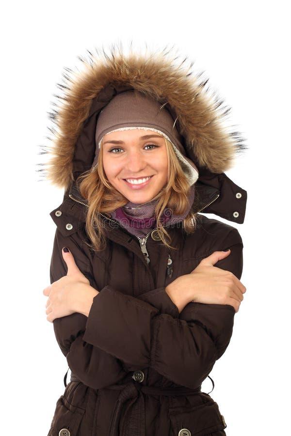Portrait of one happy frozen woman in winter coat royalty free stock photo