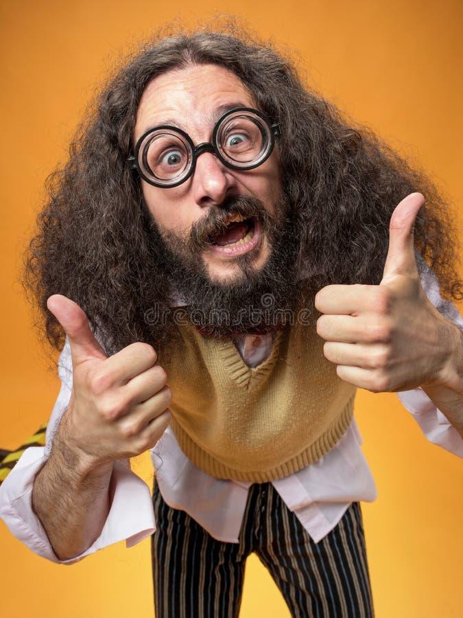 Portrait of an optimistic geek wearinf funny eyeglasses stock image