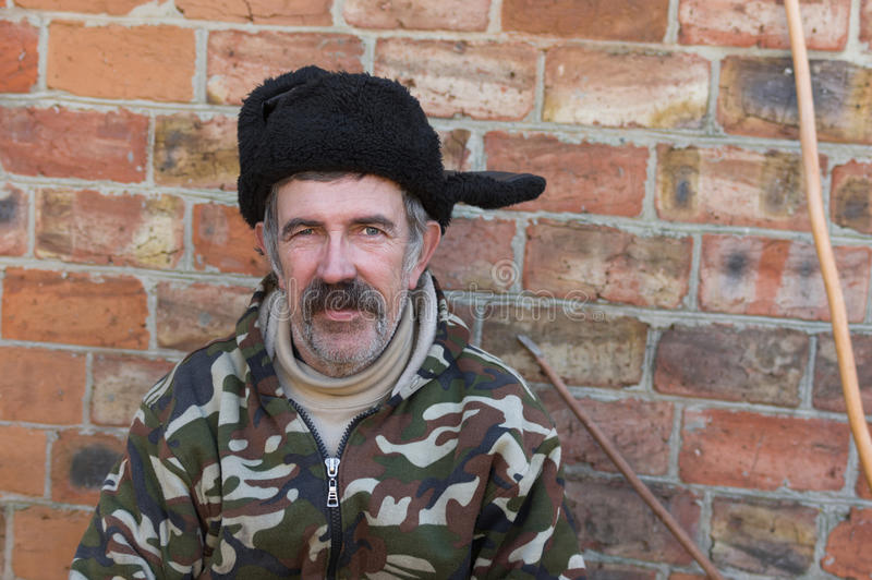 Portrait of an ordinary mustached Ukrainian peasant in fur cap stock images