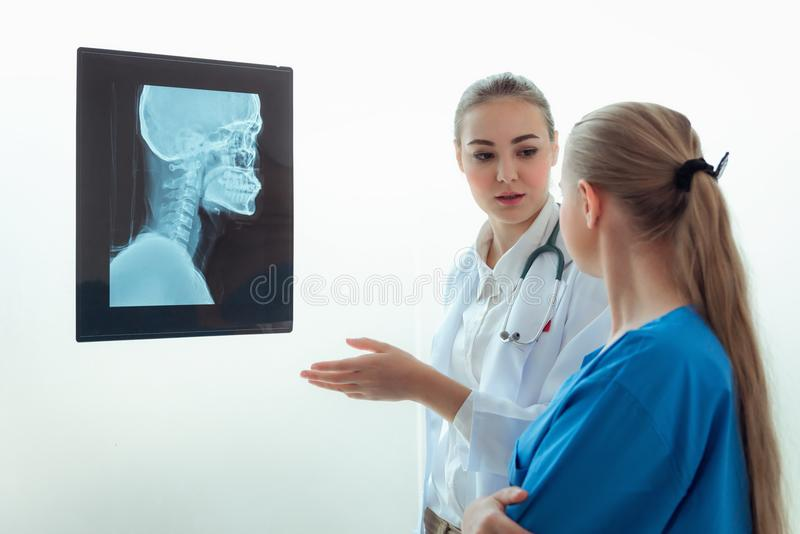Portrait of Orthopedic female doctor is explaining and consulting about health problem to her patient in examination room, Health royalty free stock photography