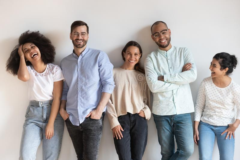 Overjoyed multiracial young people posing for group picture royalty free stock photography