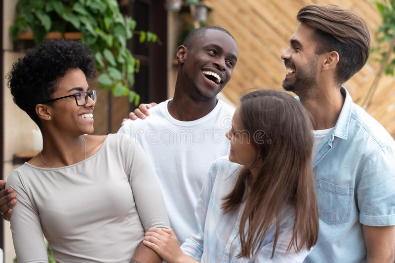 Portrait of smiling multiracial friends posing for picture stock photography