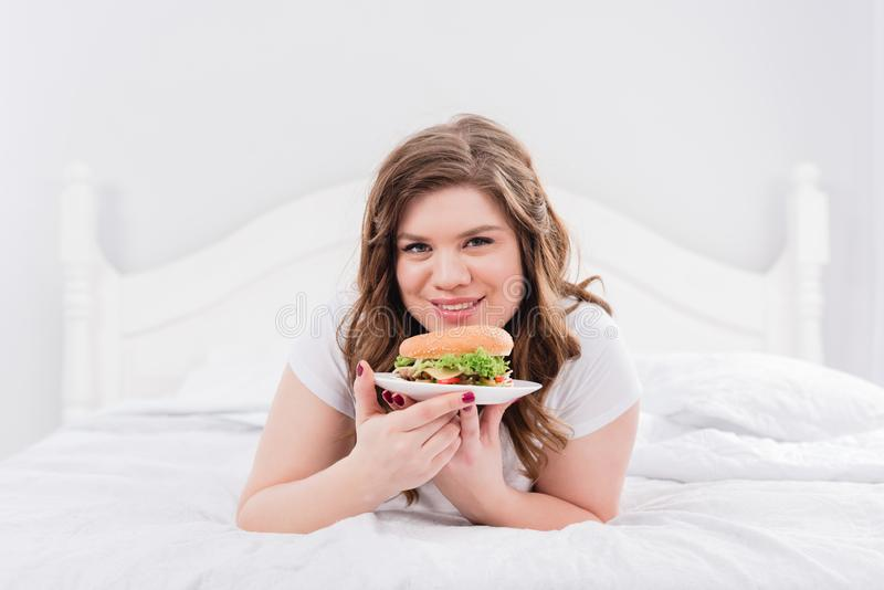 portrait of overweight smiling woman stock images