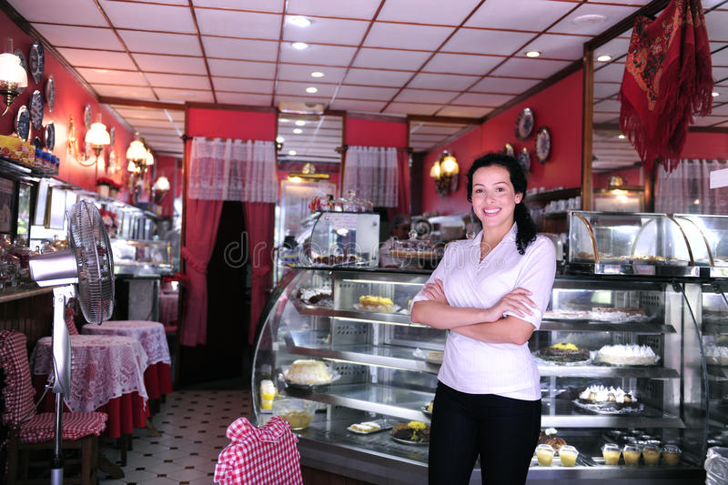 Portrait of the owner of a cafe stock photography